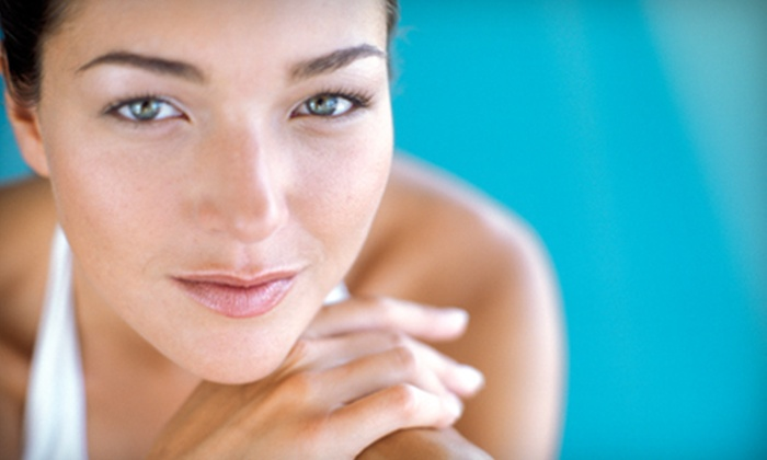Ultimate Tan & Spa - Lawrence: Microdermabrasion or Brazilian Wax at Ultimate Tan & Spa