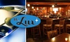 Delux Bar & Grill - Goose Island: $10 for $25 Worth of Food and Drinks at Delux Bar & Grill