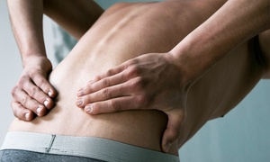 De La Fe Chiropractic: Three or Five Spinal-Decompression Treatments with Optional Massages at De La Fe Chiropractic (Up to 82% Off)