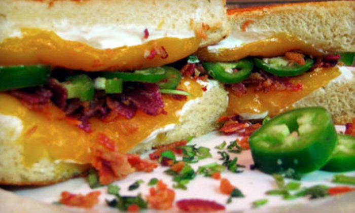 Cheesie's Pub & Grub - Lakeview: $15 for a Grilled-Cheese Dinner with Fries, Soup, and Drinks for Two at Cheesie's Pub & Grub ($31.83 Value)