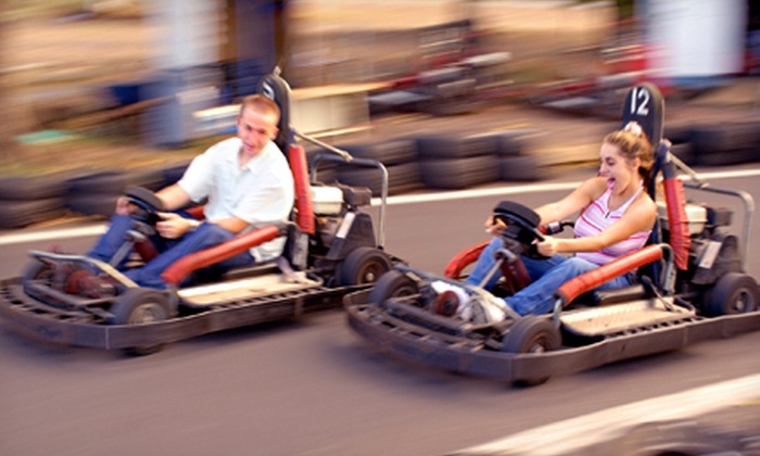 Cooter's Place - Gatlinburg: $22 for a Family Package with Five Go-Kart and Mini-Golf Passes and One Photo at Cooter's Place ($45 Value)