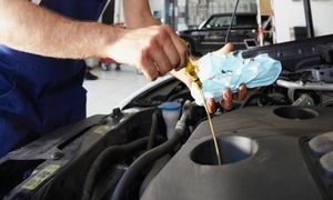 OK Tire & Auto Service: Standard or Synthetic Oil-Change Package at OK Tire & Auto Service (Up to 78% Off)