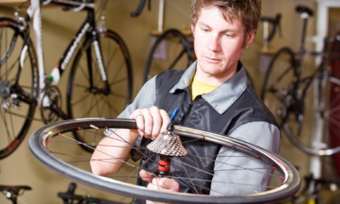 Uptown Cycles - Wesley Heights: One or Two Bike Safety Checks Plus Store Credit Toward Repair Services, Classes, and Merchandise at Uptown Cycles