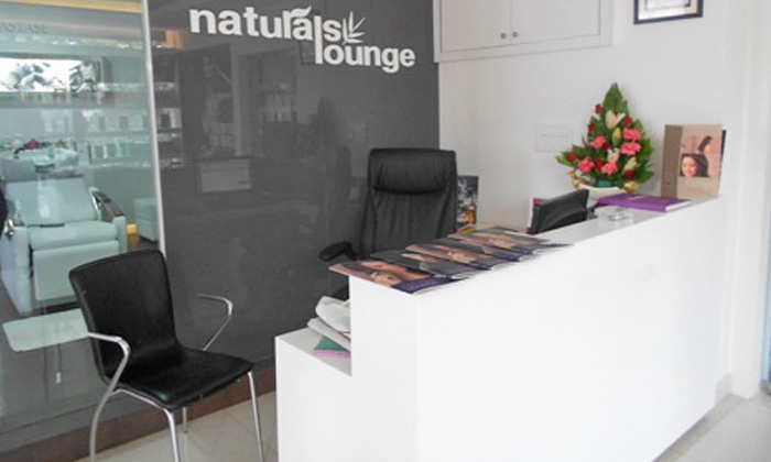 Haircut facial mani pedi more at naturals unisex salon for Accolades salon groupon