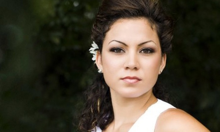 Envy Hair Salon - Nocatee: $20 for Haircut ($40 Value) or $30 for Four Feather Hair Extensions ($60 Value) at Envy Hair Salon