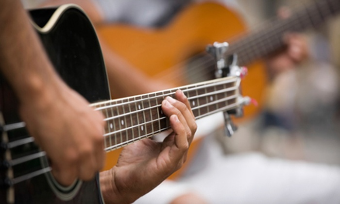 KLM Stage & Musician Services Ltd. - Southeast Calgary: $54 for Four One-Hour Group Guitar Lessons at KLM Stage & Musician Services Ltd. ($160 Value)