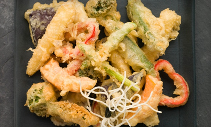 Retro Lounge & Grill - Freeport: $15 for $30 Worth of International Fusion Fare and Drinks at Retro Lounge & Grill in Freeport