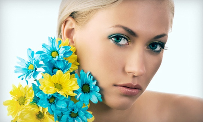 Sunkissed Tanning Salon - Tyro: One, Three, or Five Airbrush Tans or One Month of Unlimited UV Tanning at Sunkissed Tanning Salon (Up to 71% Off)