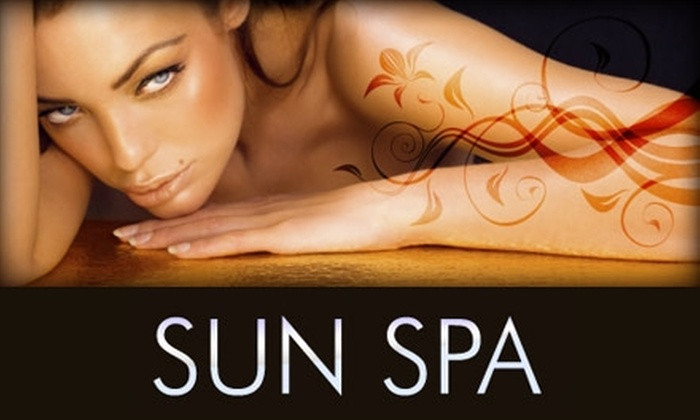 Sun Spa - Multiple Locations: $29 for One Month of Unlimited Tanning and a Bottle of Lotion or Two Brazilian Waxes at Sun Spa (Up to $115 Value)