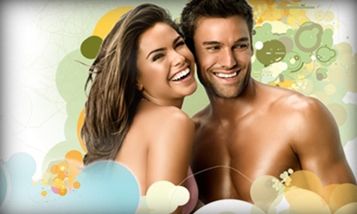 Hollywood Tans - Mooresville: $25 for One Month of Unlimited Tanning ($70 Value) or Three Spray Tans (up to $90 Value) at Hollywood Tans in Mooresville
