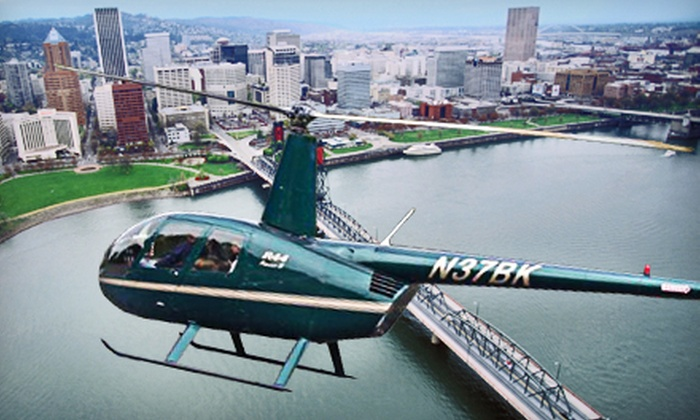 Pioneer Helicopters - Independence: 15- or 30-Minute Helicopter Tours for Up to Three People or Intro Helicopter Lesson from Pioneer Helicopters (Half Off)