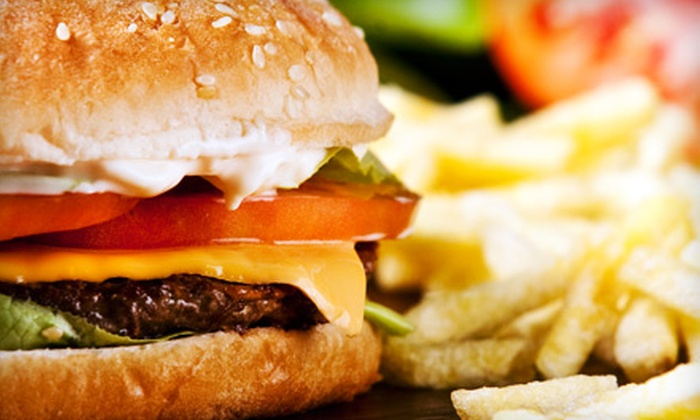 Coaches Bar & Grill - The Gables: $10 for $20 Worth of Burgers, Sandwiches and Pizza at Coaches Bar & Grill