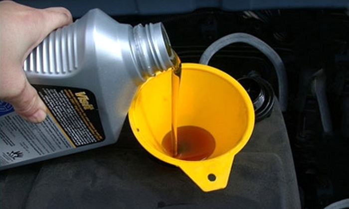 Meineke Car Care Center - Becker: $45 for an Oil Change, Maintenance Package Including Two Wiper Blades and AC Check, and More at Meineke Car Care Center ($172.65 Value). Four Locations Available.