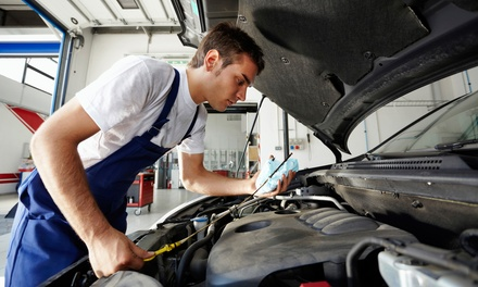 State Inspection and Emissions Test with Optional Oil Change at JMJ Automotive & Express Lube (Up to 57% Off)