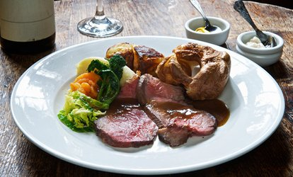 Sunday Carvery Roast with Glass of Wine or Beer for Two or Four at Charlie's Bistro (Up to 32% Off)