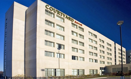 1-Night Stay for Two with Up to 14 Days of Parking and Optional Breakfast at Courtyard Montreal Airport in Montreal, QC