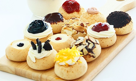 $15 for Two Groupons, Each Good for $15 Worth of Cream Puffs at Puffilicious ($30 Total Value)