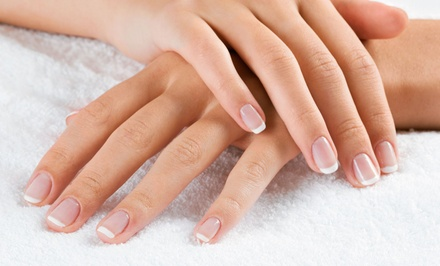 Deluxe Mani-Pedi, Full Set of Solar Tips, or Shellac Polish Manicure at AM Nails (Up to 51% Off)