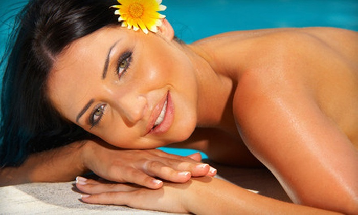 Tan at the Islands - Lake Forest: Two Mystic Spray Tans, Two UVB Tanning-Bed Sessions, or Custom Airbrush Tan at Tan at the Islands (Up to 58% Off)