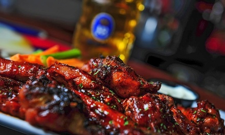 Pub Food and Drinks at Village Idiot Pub (Up to 50% Off). Two Options Available.