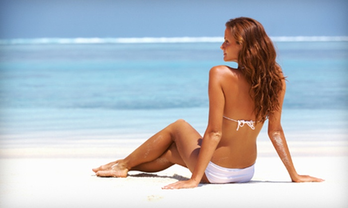 Hot Spot Tanning Spa - Phoenix: Three or Five Spray Tans, or Two Body Wraps and One Week of Unlimited UV Tanning at Hot Spot Tanning Spa (Up to 68% Off)
