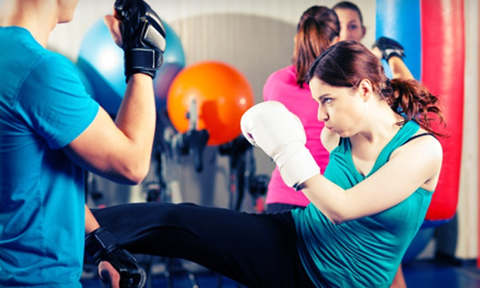 CKO Kickboxing - Multiple Locations: $29.99 for Three Kickboxing Classes with Gloves at CKO Kickboxing (Up to $85 Value)