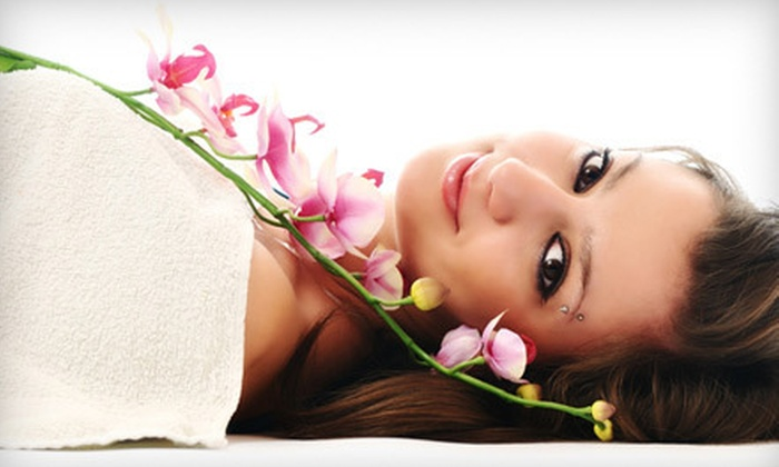 Nails R Us - West Omaha: $75 for 60-Minute Swedish Massage with Winter Shellac Manicure or Basalt-Stone Pedicure at Nails R Us (Up to $150 Value)
