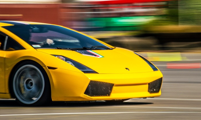 The Motorsport Lab - Dakota County Technical College: Ferrari or Lamborghini Driving Experience from The Motorsport Lab (Up to 82% Off). Four Options Available.