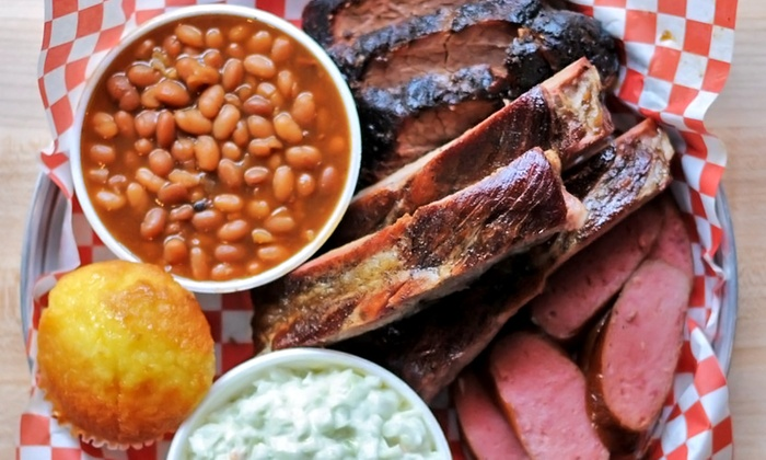 Dick's Bodacious Bar-B-Q - Mile Square: Casual American Barbecue Cuisine for Two or Four at Dick's Bodacious Bar-B-Q (38% Off)