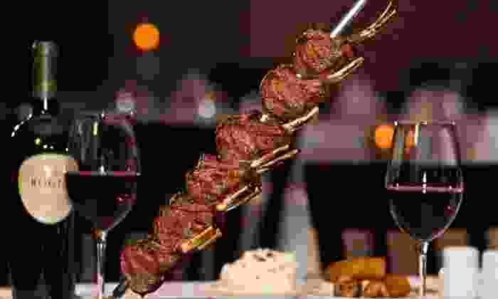 Novilhos Brazilian Steakhouse - Bellevue: Brazilian Steak-House Cuisine for Parties of Two or Four at Novilhos Brazilian Steakhouse (45% Off)