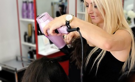 Haircut, Style, and Optional Partial Highlights at Michelle's Hair Color Boutique (Up to 52% Off)