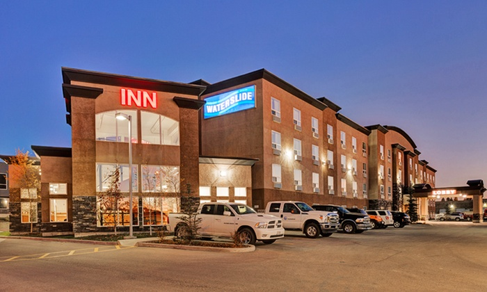 Service Plus Inn and Suites - Calgary, AB: 1-Night Stay for Up to Four with Optional Family Package at Service Plus Inn and Suites in Calgary, AB