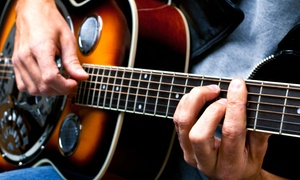 American Guitar Academy: $49 for Four Private Guitar Lessons with Free Lesson e-Book at American Guitar Academy ($ 129.95 Value)