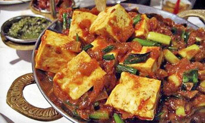 Curry & Crust Indian Cuisine & Desi Pizza - Northeast Hillsboro: Indian Cuisine and Pizza at Curry & Crust Indian Cuisine & Desi Pizza (Up to 45% Off). Three Options Available.