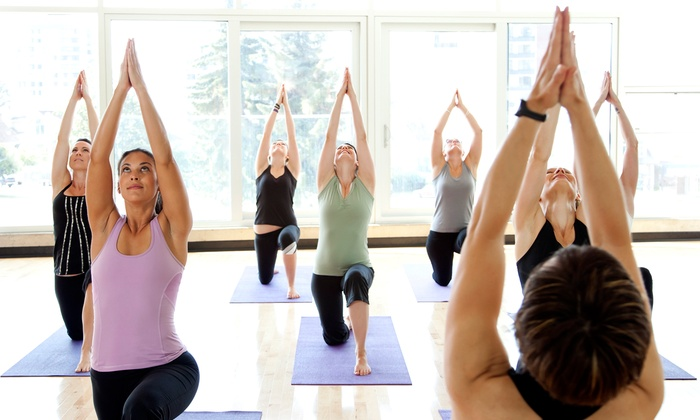 East Meets West Yoga Center - Old Courthouse: 5, 10, or 20 Yoga Classes at East Meets West Yoga Center (Up to 66% Off)
