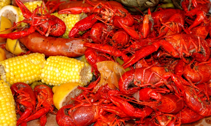 LIttle New Orleans Kitchen & Oyster Bar - LIttlie New Orleans: Pounds of Crawfish with Corn and Potatoes for Two or Four at Little New Orleans Kitchen & Oyster Bar (50% Off)