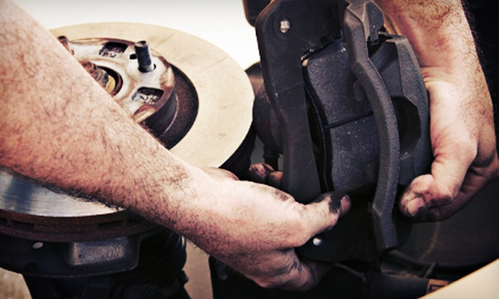 Meineke Car Care Center - Fresno: Brake Services at Meineke Car Care Center (Up to 57% Off). Two Options Available.