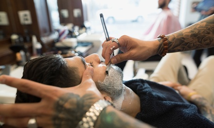 Hot Towel Shave Package or Men's Grooming Package at Blood and Bandages Barbers Shop