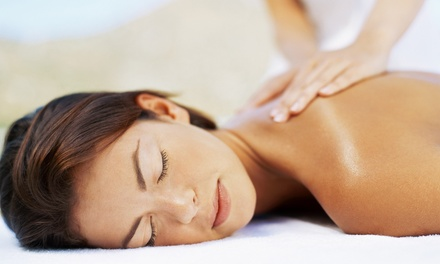 $49 for 60-Minute Massage with Hot Stones or Scalp Treatment at At Peace Floatation & Massage ($110 Value)