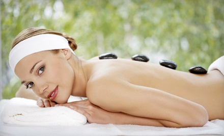 Sixty-Minute Hot Stone Massage with Optional Ionic Foot Bath at You Potentiality (Up to 57% Off)