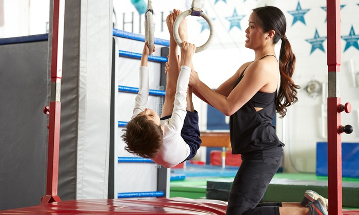 Elite Gymnastics & Cheer - Owasso: Boost Your Kid's Coordination with a Gymnastics Class at Elite Gymnastics & Cheer