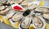 Eats on Lex - Upper East Side: $39 for Two Dozen Oysters and Two Signature Martinis at Eats on Lex (Up to $102 Value)