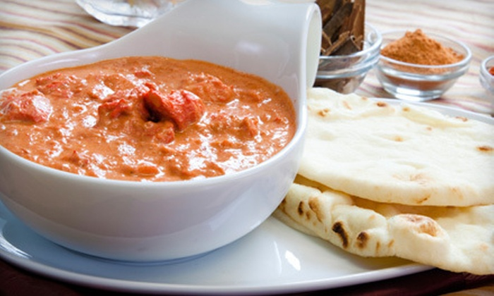 Akbar's Own - South Granville: Indian Cuisine for Two or Four at Akbar's Own (Half Off)