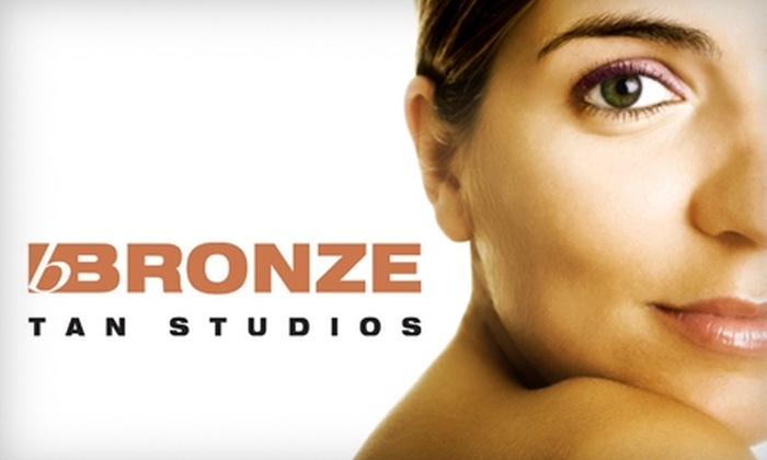 Bronze Tan Studios - Multiple Locations: $25 for 30 Days of Gold Club Tanning or Two Spray Tans at Bronze Tan Studios (Up to $72 Value)