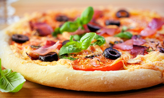 Top Tomato Pizza Cafe - Center City East: Pizza, Calzones, Pasta, and Sandwiches for Two, Four, or Six at Top Tomato Pizza Cafe (Up to 53% Off)