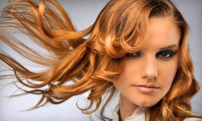 Justice Designs Studio Salon - Charleston: $30 for a Haircut Package with Deep Conditioning, Scalp Massage, and Wine at Justice Designs Studio Salon ($60 Value)