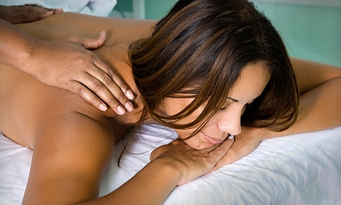 Therapeutic Touch - Interstate Business Park: $35 for a Massage and Foot Treatment ($75 Value) or $50 for Eyelash Extensions ($100 Value) at Therapeutic Touch