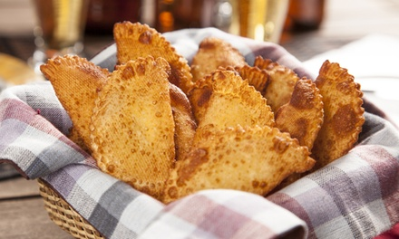 $18 for Dinner for Two of 12 Empanadas and 2 Juices at Empanadas Monumental ($42.20 Value)