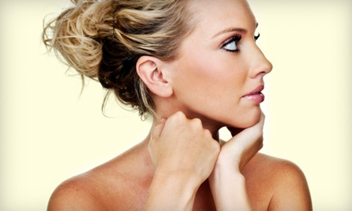 Tanglz Salon - Menasha: $50 for Three Airbrush Tans at Tanglz Salon ($105 Value)