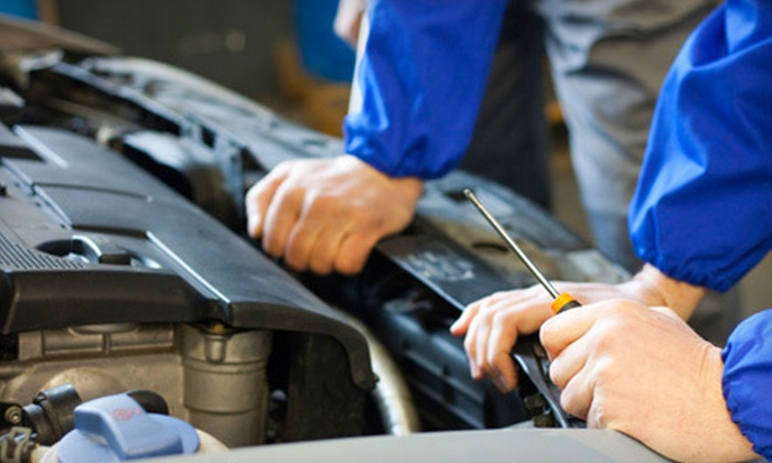 Wiygul Automotive Clinic - Multiple Locations: Nonsynthetic or Synthetic Oil Change with Brake Inspection, Tire Nitrogen Conversion, and Tire Rotation at Wiygul Automotive Clinic (Up to 84% Off)